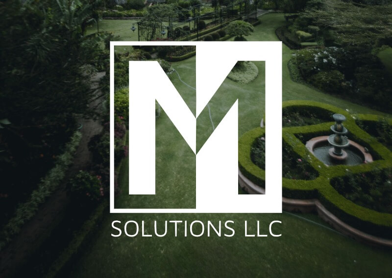 M Solutions LLC logo overlayed on an image of a beautiful garden.